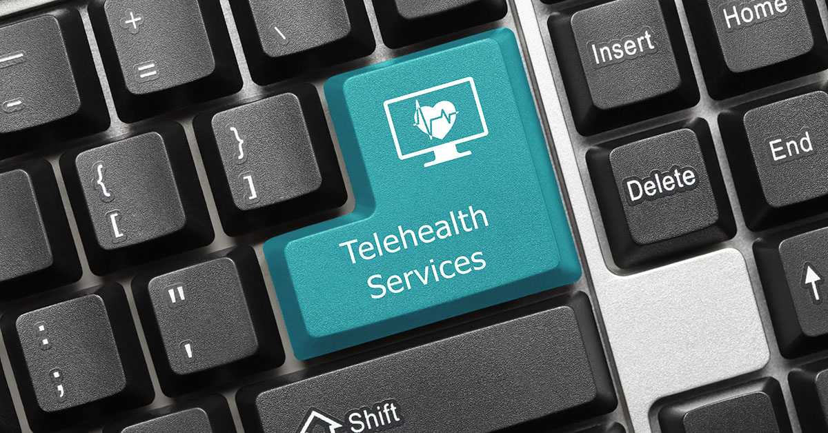 Close-up view on conceptual keyboard - Telehealth Services (blue key); blog: telehealth services