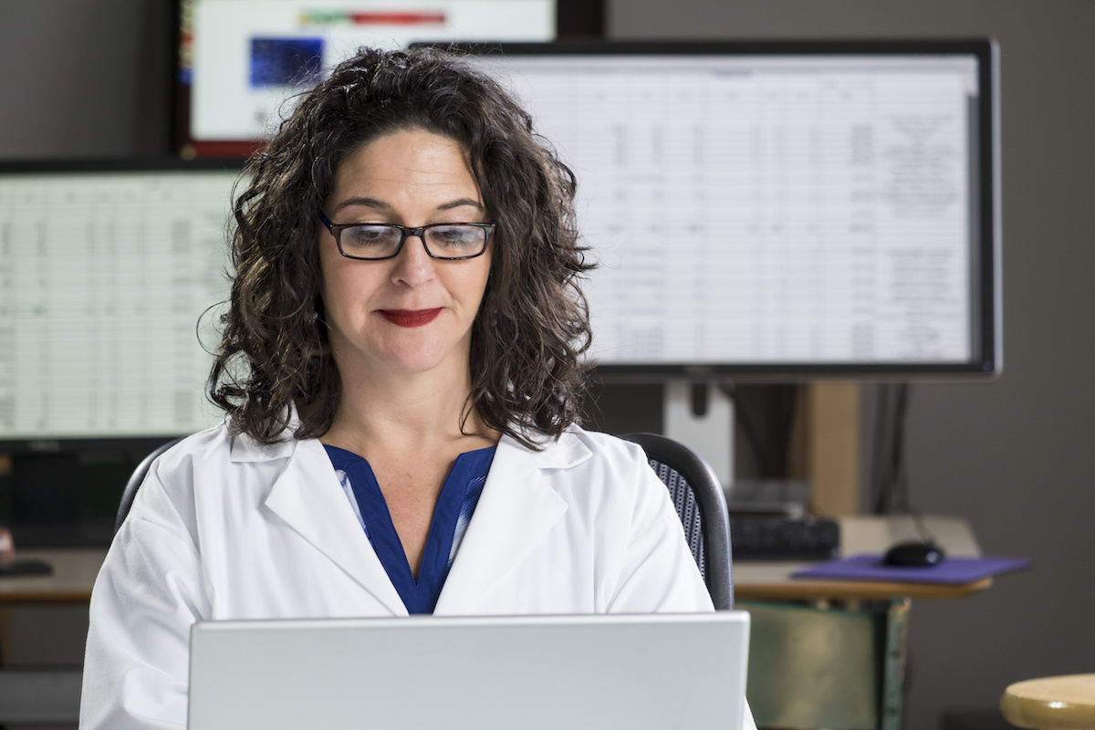 Health professional entering data into computer; blog: reasons to outsource medical billing